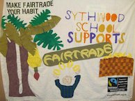 Fairtrade banner made on fairtrade cotton by the children of Sythwood School