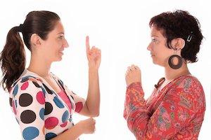 Two women speaking sign language