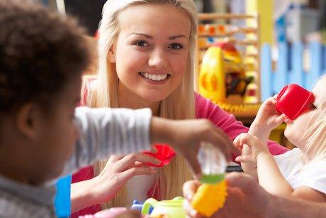 Nursery worker with children