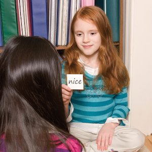 Two girls doing a literacy activity