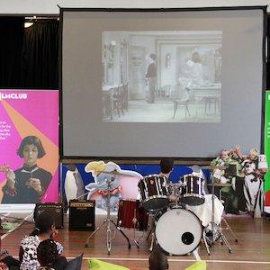 School of rock - drummer and screen