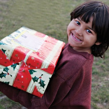 Child in Romania receiving gifts