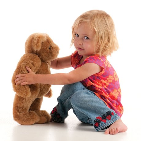 Goldilocks girl playing with bear