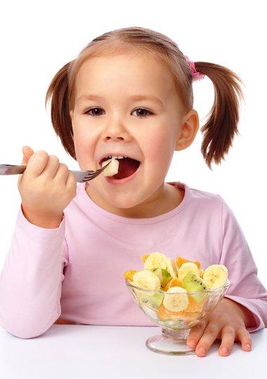 Child eating a fruit salad