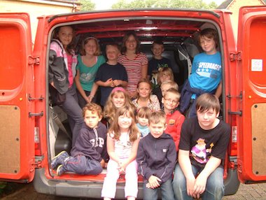 Children in a post van