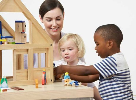 Children with toy house