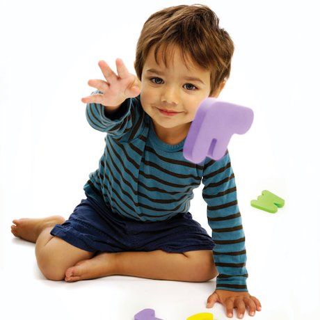 Boy throwing foam letters