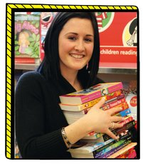 Book Fair Takeover photo - teacher holding books
