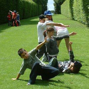 Schoolchildren dancing at Hidcote Manor