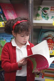 Girl reading Fairs Autumn 2010