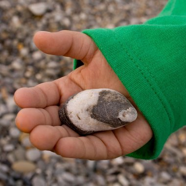 Child holding a pebble