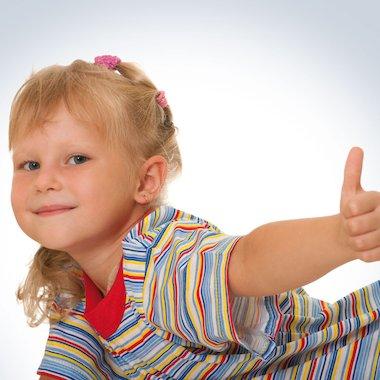Girl doing 'thumbs up'