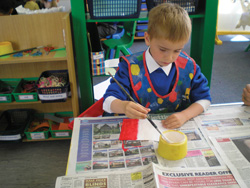Young boy painting French flag
