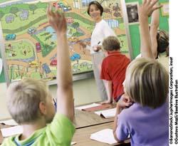 Teacher and children in a classroom