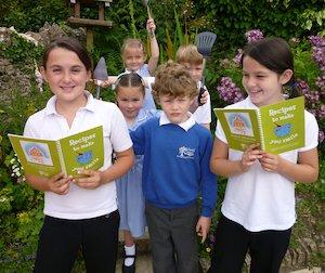 Children with recipe book
