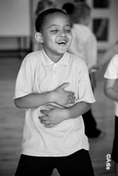 Boy participating in an Artis-led activity