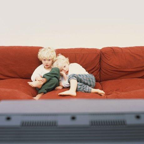 Children watching a television