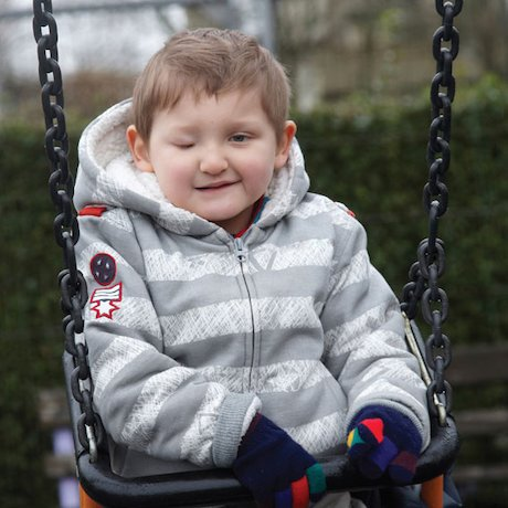 Visually impaired child at a playground