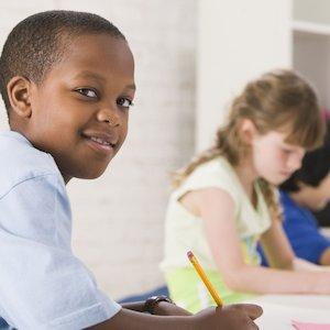 Boy in classroom writing