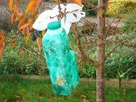 Plastic milk carton bird feeder