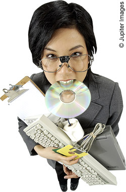 teacher carrying ICT equipment