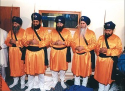 Sikhs displaying the five ks