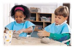 Children making cinnamon clay