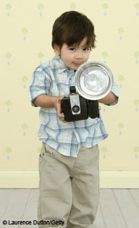 child with old-fashioned camera