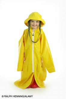 girl dressed in large raincoat